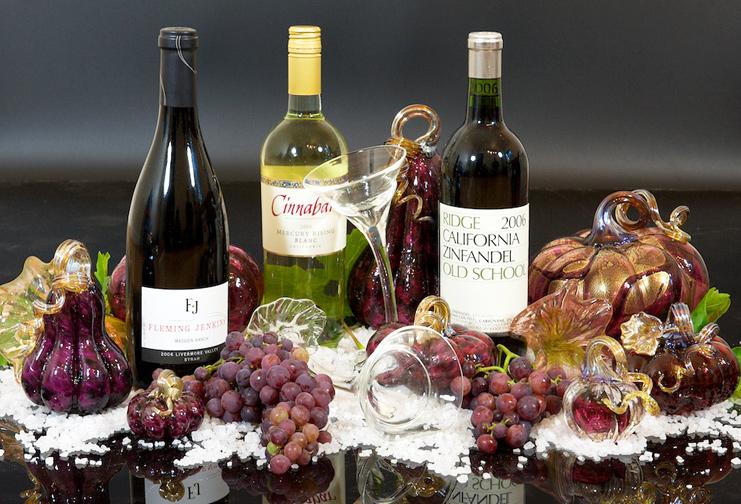 Glass pumpkin display with wine