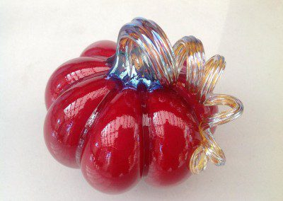 Shiny crimson glass pumpkin